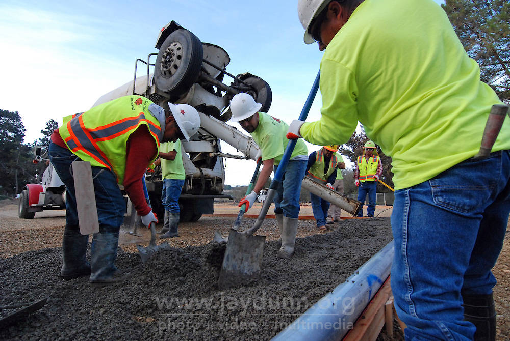 A full crew from San Benito Supply pour the first pervious concrete on Tuesday morning, October 27th, 2015 at the Acosta Plaza Recreation Area in east Salinas, CA. The surface is designed to drain water easily.