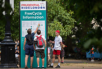 Spectators looking at the FreeCycle Information Board. The Prudential RideLondon FreeCycle. Saturday 28th July 2018<br /> <br /> Photo: Jed Leicester for Prudential RideLondon<br /> <br /> Prudential RideLondon is the world's greatest festival of cycling, involving 100,000+ cyclists - from Olympic champions to a free family fun ride - riding in events over closed roads in London and Surrey over the weekend of 28th and 29th July 2018<br /> <br /> See www.PrudentialRideLondon.co.uk for more.<br /> <br /> For further information: media@londonmarathonevents.co.uk