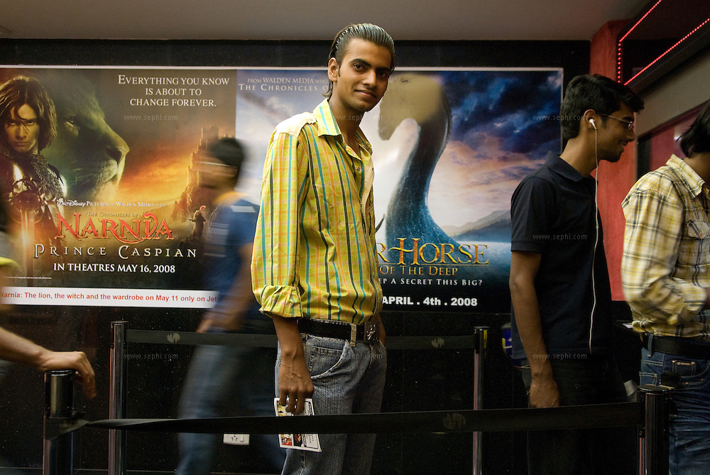 Sajid (21) standing in line at the ticket counter of the Wave cinema complex at Center Stage mall in Noida.