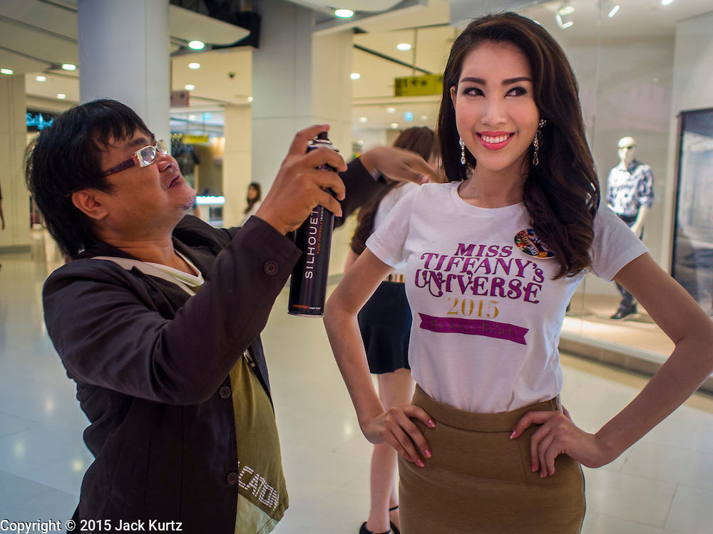 25 MARCH 2015 - BANGKOK, THAILAND: A contestant gets her hair touched up during the first round of the Miss Tiffany's contest at CentralWorld, a large shopping mall in Bangkok. Miss Tiffany's Universe is a beauty contest for transgender contestants; all of the contestants were born biologically male. The final round will be held on May 8 in the beach resort of Pattaya. The final round is televised of the  Miss Tiffany's Universe contest is broadcast live on Thai television with an average of 15 million viewers.     PHOTO BY JACK KURTZ
