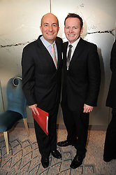Left to right, KIT HESKETH-HARVEY and musician JOE STILGOE at the Lady Taverners Tribute Lunch in honour of Nicholas Parsons held at The Dorchester, Park Lane, London on 20th November 2009.