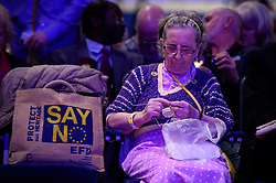 ©  London News Pictures. 17/09/2016. Bournemouth, UK. A UKIP party supporter doing her knitting during a break at Day  2 of the 2016 UKIP Autumn Conference, held at the Bournemouth International Centre in Bournemouth, Dorset. On Friday, the party elected Diane James as their new leader, following Nigel Farage resignation after the UK voted to leave the EU in a referendum..  Photo credit: Ben Cawthra/LNP