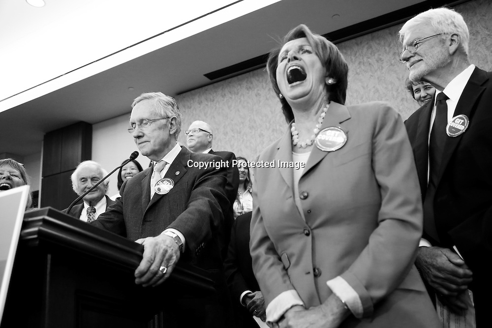 U.S. House Minority Leader Nancy Pelosi (R) laughs as Senate Majority Leader Harry Reid (L) makes a joke about Republican opposition to federal health plans at a rally to celebrate the start of the Affordable Care Act (commonly known as Obamacare) at the U.S. Capitol in Washington, October 1, 2013. The U.S. government began a partial shutdown for the first time in 17 years, potentially putting up to 1 million workers on unpaid leave, closing national parks and stalling medical research projects.