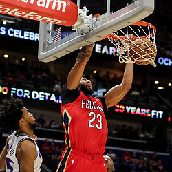 Oct 19, 2018; New Orleans, LA, USA; New Orleans Pelicans forward Anthony Davis (23) dunks over Sacramento Kings forward Marvin Bagley III (35) during the first quarter at the Smoothie King Center. Mandatory Credit: Derick E. Hingle-USA TODAY Sports