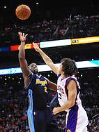 Mar. 10, 2011; Phoenix, AZ, USA; Denver Nuggets guard Raymond Felton (20) puts up a basket against the Phoenix Suns guard Steve Nash (13) at the US Airways Center. Mandatory Credit: Jennifer Stewart-US PRESSWIRE