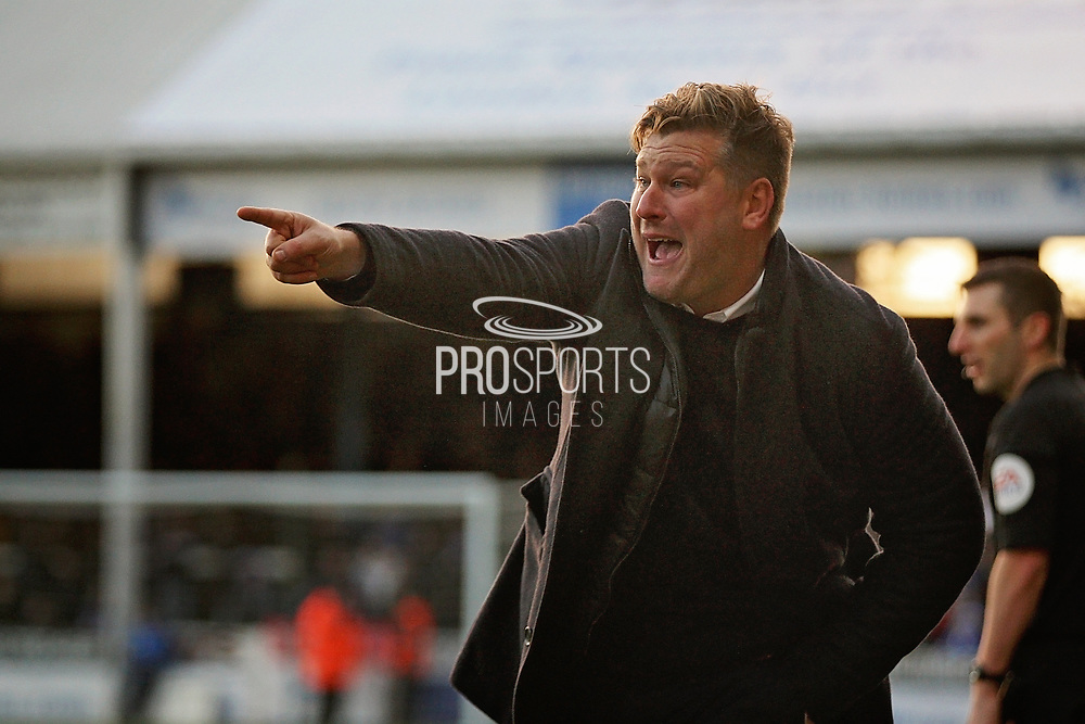 Oxford United's manager Karl Robinson points out a plan  during the EFL Sky Bet League 1 match between Peterborough United and Oxford United at London Road, Peterborough, England on 8 December 2018.
