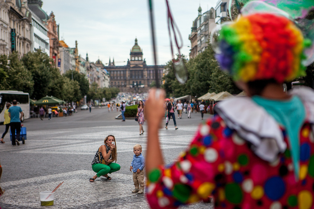 "A clown is doing a ""bubble"" performance at Wenceslas Square in Prague."