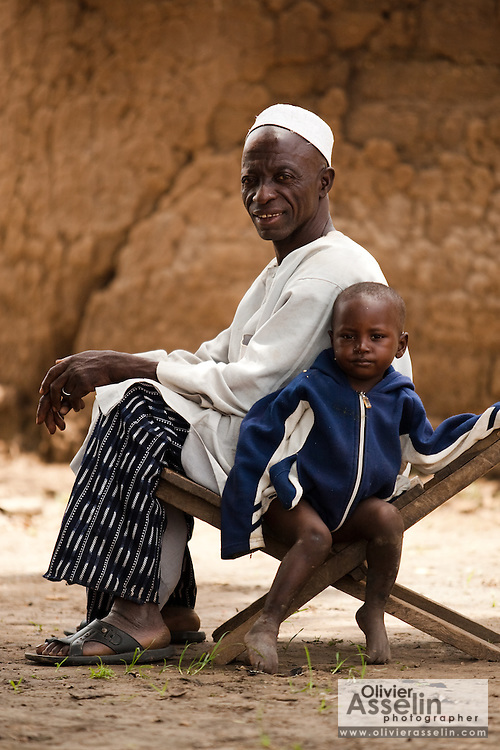 A boy sits next to an elderly man in the village of Banankoro, Mali on Saturday August 28, 2010.