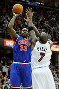 Feb 4, 2010; Cleveland, OH, USA; Cleveland Cavaliers center Shaquille O'Neal (33) shoots over Miami Heat center Jermaine O'Neal (7) during the third quarter at Quicken Loans Arena. The Cavaliers beat the Heat 102-86. Mandatory Credit: Jason Miller-US PRESSWIRE