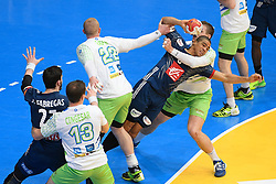 Narcisse Daniel between Matej Gaber and Vid Poteko during 25th IHF men's world championship 2017 match between France and Slovenia at Accord hotel Arena on january 24 2017 in Paris. France. PHOTO: CHRISTOPHE SAIDI / SIPA. / Sportida