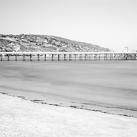 Malibu Pier black and white panoramic photo at Surfrider Beach. Malibu is a California beach city along the Pacific Ocean in the Western United States