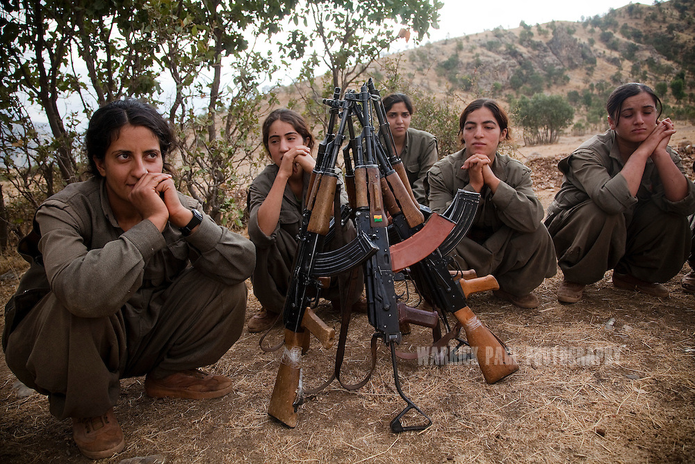 QANDIL MOUNTAINS, IRAQI KURDISTAN - SEPTEMBER 19: Female fighters in the PKK relax after training exercise, on September 19, 2010, in the Qandil Mountains, Iraqi Kurdistan. Labelled as terrorists by the Turkish, US and EU, it's in the Qandil Mountains near the border where the guerrillas of the PKK live and wage their 26 year war against Turkey that has claimed over 40,000 lives. (Photo by Warrick Page)