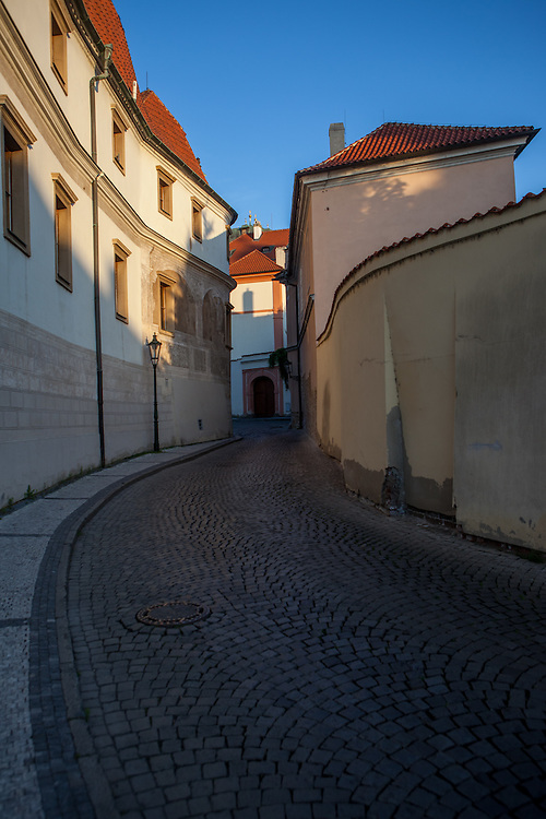 Kanovicka street leading to the Prague Castle Square during later evening.