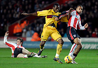 Photo: Alan Crowhurst.<br />Southampton v Burnley. Coca Cola Championship. 13/01/2007. Saints' David McGoldrick (R) challenges with Eric Djemba-Djemba.