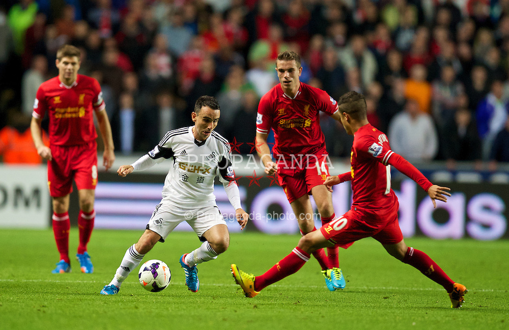 SWANSEA, WALES - Monday, September 16, 2013: Swansea City's Leon Britton in action against Liverpool during the Premiership match at the Liberty Stadium. (Pic by David Rawcliffe/Propaganda)