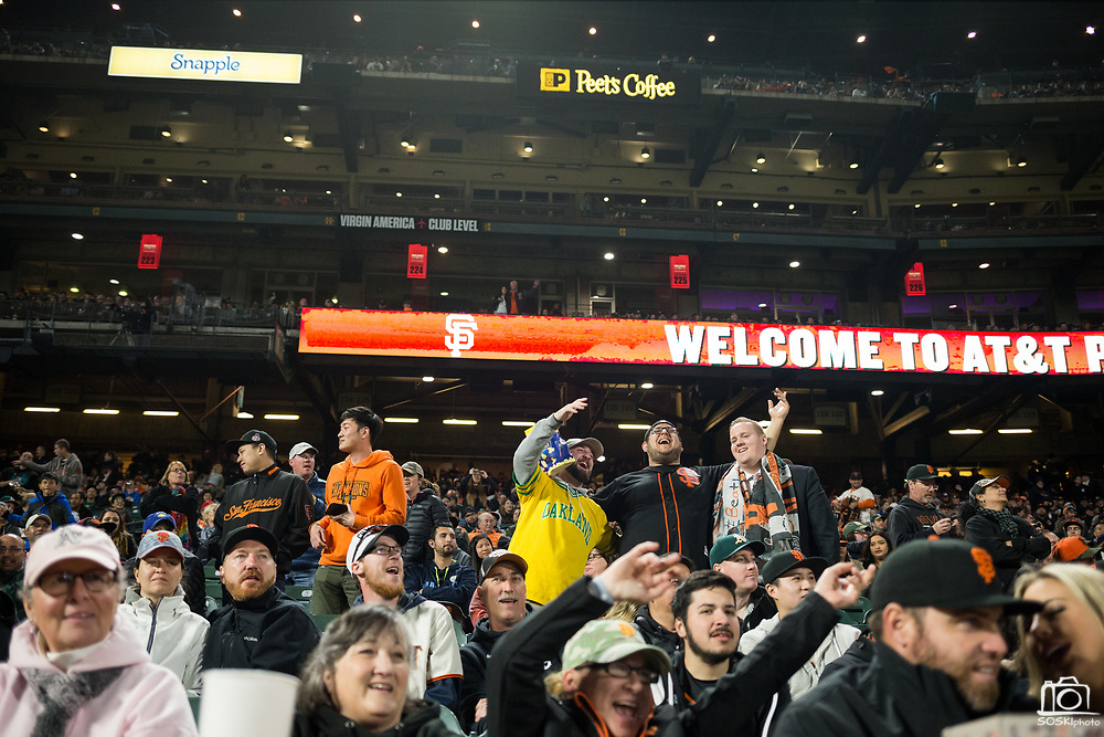 San Francisco Giants and Oakland Athletics fans sing during the 7th Inning Stretch at AT&T Park in San Francisco, California, on March 30, 2017. (Stan Olszewski/Special to S.F. Examiner)
