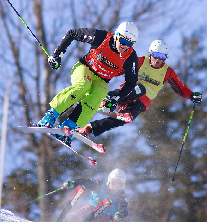 -20110211- Collingwood, Ontario,Canada -- Filip Flisar of Slovakia leads Sylvain Miaillier of France during their quarter final race at the Rockstar Ski Cross Grand Prix race at Blue Mountain in Collingwood, Ontario, February 11, 2011.<br /> AFP PHOTO/Geoff Robins