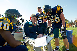 Penn Charter Quakers players listen as a coach draws up plays.<br /> <br /> Philadelphia, PA, United States, November 9, 2019: Young male student athletes compete in 'the oldest uninterrupted schoolboy football rivalry in the US&quot; as part of the annual PC/GA Day sports event.<br /> <br /> The annual football rivalry is the main event of the sportive meet between two Philadelphia Area private schools: William Penn Charter School and Germantown Academy. At the 127th edition the GA Patriots break a long standing winning streak of the Penn Charter Quakers.<br /> <br /> 127th edition of the PC/GA day is held on the campus of William Penn Charter School in the Northwest section of Philadelphia, PA, USA on November 9, 2013.