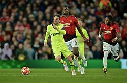 MANCHESTER, ENGLAND - Thursday, April 11, 2019: Barcelona's captain Lionel Messi and Manchester United's Paul Pogba during the UEFA Champions League Quarter-Final 1st Leg match between Manchester United FC and FC Barcelona at Old Trafford. Barcelona won 1-0. (Pic by David Rawcliffe/Propaganda)