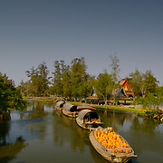 Typical old Thai style river barges at Muang Borang in Samut Prakarn, Thailand.