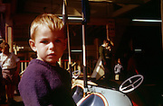 A young boy has his photo taken at the fairground on Southend seafront in the early nineteen sixties.