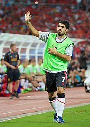 BANGKOK, THAILAND - Sunday, July 28, 2013: Liverpool's Luis Suarez waves to the crowd during a preseason friendly match against Thailand XI at the Rajamangala National Stadium. (Pic by David Rawcliffe/Propaganda)