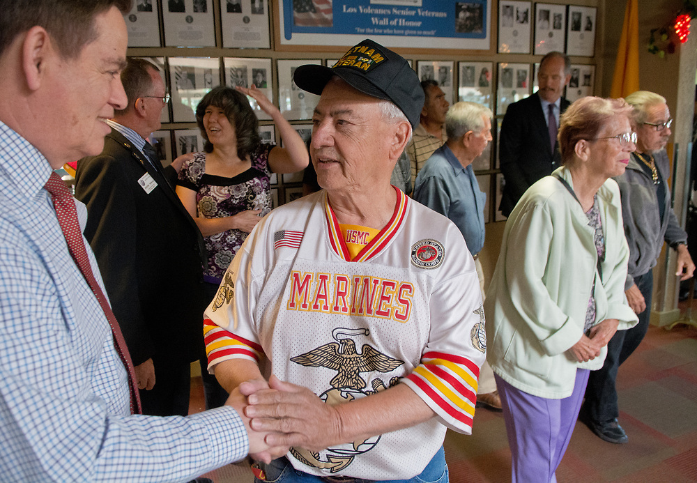 "mkb061517b/west/Marla Brose --  Juan Garcia shakes hands with City Councilor Ken Sanchez, left, after Mayor Richard Berry hung up a portrait of Garcia along with 38 other veterans on the Los Volcanes Senior Center's Wall of Honor, Thursday, June 15, 2017, in Albuquerque, N.M. ""This means a lot. It's an individual honor,"" said Teresa Garcia, Juan's wife. All of the senior centers in Albuquerque will have their own Wall of Honor for a total of about 260 senior veterans, said Roger Newall of the city's Veterans Affairs.  (Marla Brose/Albuquerque Journal)"