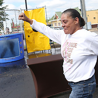Lauren Wood | Buy at photos.djournal.com<br /> Sandra Tate celebrates after successfully dunking Kayla Buckner Thursday morning during the Dunk A Boss fundraiser at the Courtyard by Marriott hotel. Both Tate and Buckner are employees of the hotel, and proceeds from the fundraiser will benefit Habitat for Humanity.