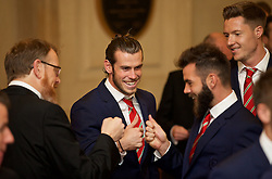 CARDIFF, WALES - Monday, October 5, 2015: Wales' head of international affairs Mark Evans, Gareth Bale, Joe Ledley and goalkeeper Wayne Hennessey during the FAW Awards Dinner Dinner at Cardiff City Hall. (Pic by David Rawcliffe/Propaganda)