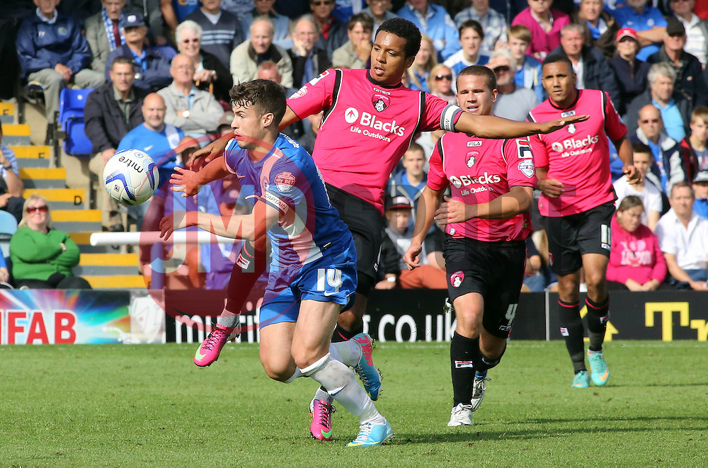 Peterborough United's Tommy Rowe in action with Oldham Athletic's Korey Smith  - Photo mandatory by-line: Joe Dent/JMP - Tel: Mobile: 07966 386802 17/08/2013 - SPORT - FOOTBALL - London Road Stadium - Peterborough -  Peterborough United V Oldham Athletic - Sky Bet League One