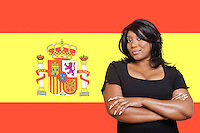 Portrait of casual mixed race woman against Spanish flag