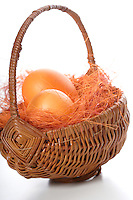 Orange easter eggs in basket