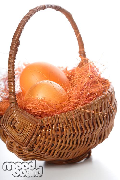 Orange easter eggs in basket