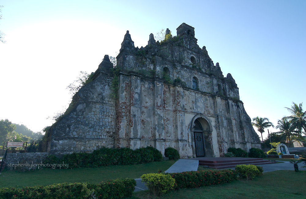 St Augustin Church of Paoay, Ilocos Norte, The Philippines. Parish founded by Augustinian missionaries in 1593; damaged by earthquakes in 1707 & 1927. Used before completion and kept in repair by the people under the joint auspices of church and the town officials. Inauguration ceremonies, 28 February, 1896.