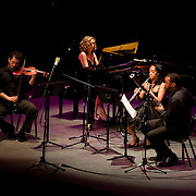 May 14, 2011 - Manhattan, NY : .Toyin Spellman-Diaz (oboe), Bryan Young (bassoon), Irina Kaplan Lande (piano) and Anton Lande (guest violin) perform the New York premiere of Astor Piazzolla's 'Chau Paris' during Symphony Space's Wall to Wall Sonidos concert on Saturday night. .CREDIT: Karsten Moran for The New York Times