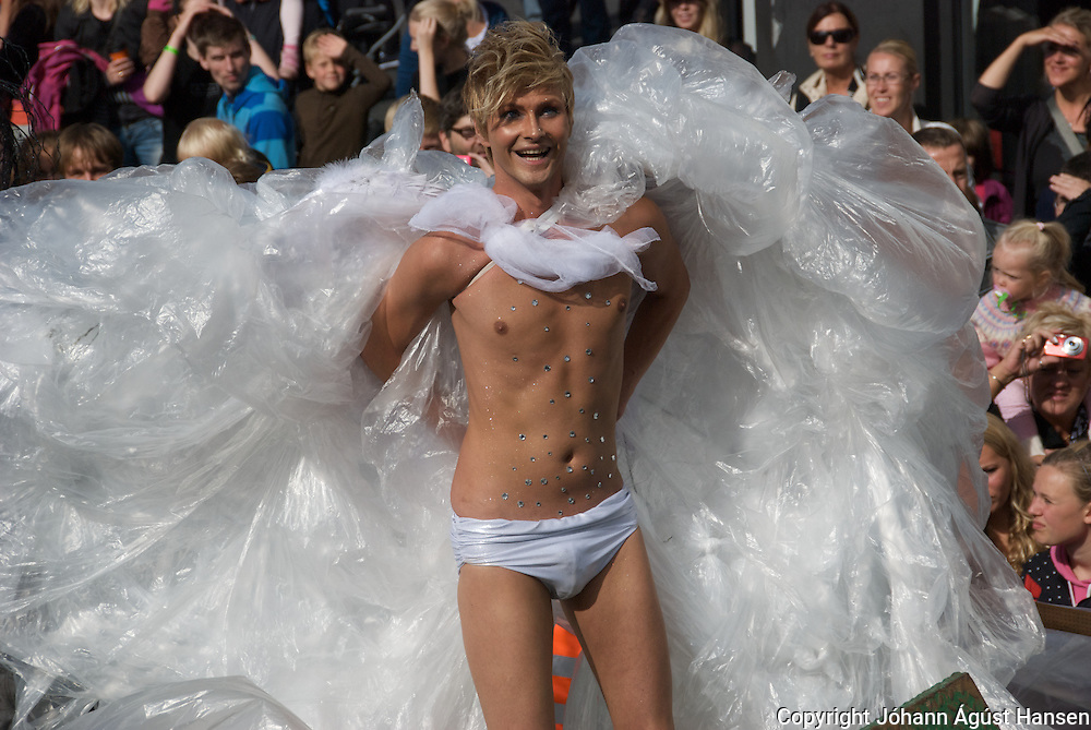 Tens of thousands of people marched through the streets of Reykjavik Saturday to celebrate gay pride and call for further rights. The march was led by the mayor of Reykjavik, Mr. Jon Gnarr, who was dressed up in drag and singer Paul Oscar.