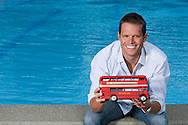 Swimmer Dominik MEICHTRY of Switzerland poses in street clothes and a London bus during a portrait session at the Waterworld Wallisellen in Wallisellen, Switzerland, Tuesday, May 15, 2012. (Photo by Patrick B. Kraemer / MAGICPBK)