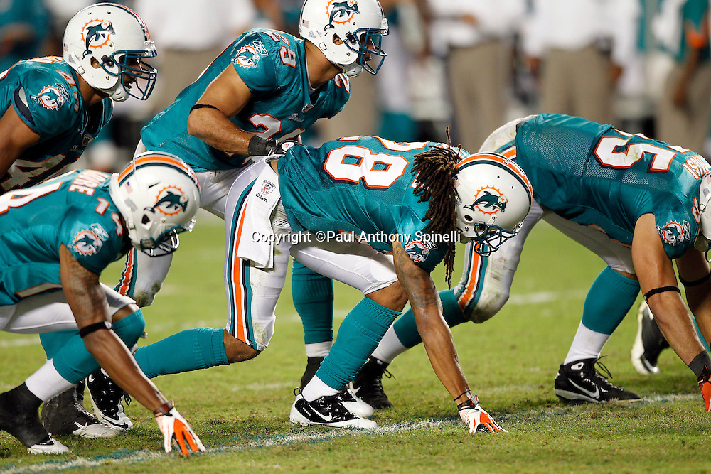 The Miami Dolphins defense gets set at the line of scrimmage during the NFL week 11 football game against the Chicago Bears on Thursday, November 18, 2010 in Miami Gardens, Florida. The Bears won the game 16-0. (©Paul Anthony Spinelli)
