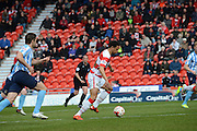 Doncaster Rovers No14 Nathan Tyson Challenges The Coventry Defence during the Sky Bet League 1 match between Doncaster Rovers and Coventry City at the Keepmoat Stadium, Doncaster, England on 23 April 2016. Photo by Stephen Connor.