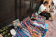 27 APRIL 2005 - SAN CRISTOBAL DE LAS CASAS, CHIAPAS, MEXICO: A woman makes dolls and handicrafts to sell to tourists in San Cristobal de las Casas, Chiapas, Mexico. San Cristobal de las Casas is an important tourist destination for those who want to visit Mexican colonial cities. San Cristobal is the center of the Chiapas highlands and an important indigenous community. Fear of political violence in the area has diminished in recent years and the tourism industry has rebounded as a result.  PHOTO BY JACK KURTZ