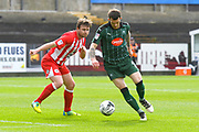 Jimmy Spencer (9) of Plymouth Argyle on the attack watched by Mark Hughes (3) of Accrington Stanley during the EFL Sky Bet League 2 match between Plymouth Argyle and Accrington Stanley at Home Park, Plymouth, England on 1 April 2017. Photo by Graham Hunt.