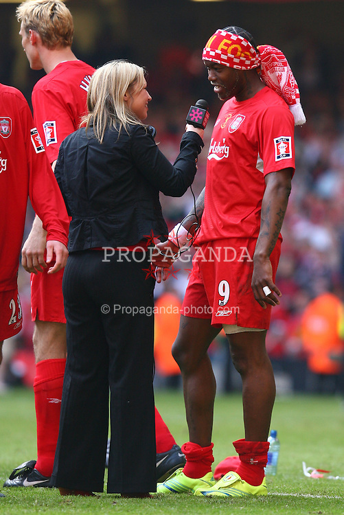 CARDIFF, WALES - SATURDAY, MAY 13th, 2006: Liverpool's Djibril Cisse is interviewed by a Radio City journalist on the pitch after winning the FA Cup following a penalty-shoot out victory over West Ham United during the FA Cup Final at the Millennium Stadium. (Pic by David Rawcliffe/Propaganda)