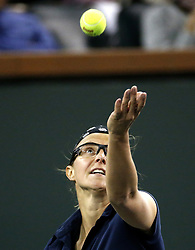 March 7, 2019 - Los Angeles, California, U.S - Eugenie Bouchard of Canada, serves the ball to Kristen Flipkens of Belgium during the women singles first round match of the BNP Paribas Open tennis tournament on Thursday, March 7, 2019 in Indian Wells, California. (Credit Image: © Ringo Chiu/ZUMA Wire)