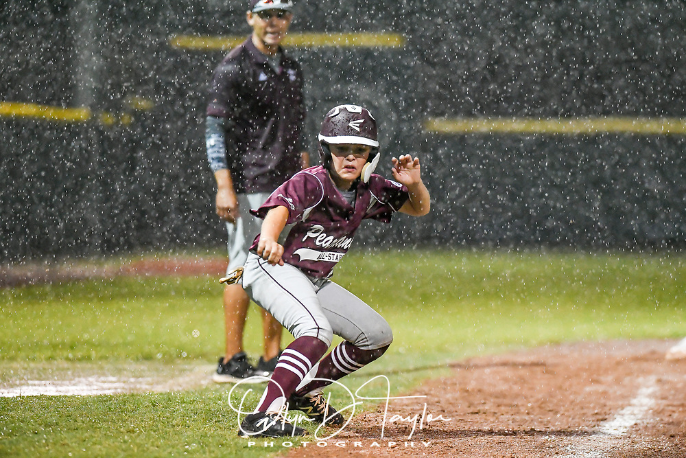 Pearland East All Stars' coach Gil Avalos looks on as Bentley Martinez (2) takes a big lead off of 3rd late in the game against Sagemont All Stars.  Pearland won 12-2. (Photo/Olyn D. Taylor)
