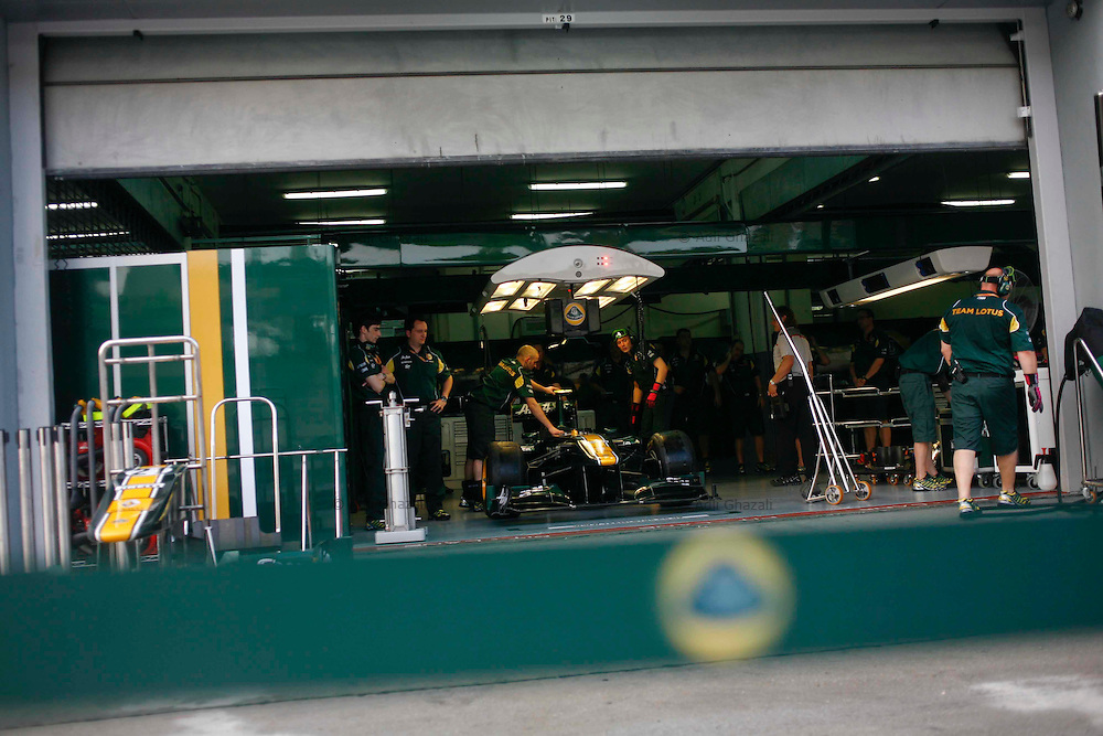 Team Lotus's crew member in action while prepares for the Malaysian Formula One Grand Prix in Sepang, Malaysia, Thursday, April 7, 2011.