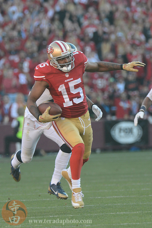 December 1, 2013; San Francisco, CA, USA; San Francisco 49ers wide receiver Michael Crabtree (15) runs with the ball against the St. Louis Rams during the third quarter at Candlestick Park. The 49ers defeated the Rams 23-13.