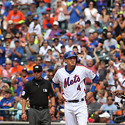 NEW YORK, NEW YORK - July 03: Fans applaud Wilmer Flores #4 of the New York Mets on first base after another of his six hits during the Chicago Cubs Vs New York Mets regular season MLB game at Citi Field on July 03, 2016 in New York City. (Photo by Tim Clayton/Corbis via Getty Images)