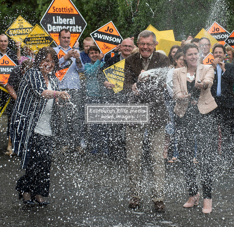 Scottish Lib Dem leader Willie Rennie celebrates quadrupling the party's MP's at the general election with champagne, with new MP's Jo SWinson and Christine Jardine and local activists.<br /> <br /> © Dave Johnston/ EEm