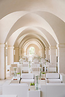 "FASANO, ITALY - 22 JULY 2018: A view of the portico and the tables of the restaurant ""Due Camini"", at Borgo Egnazia, a high-end resort in Puglia, on Italy's eastern coast, in Fasano, Italy, on July 22nd 2018.<br /> <br /> Borgo Egnazia, modeled after a 15th century Apulian village, rolls out over 250 acres on a plot of land originally razed by Mussolini and intended as an air force base, ending nearing the Adriatic. Aldo Melpignano, the 40 years old owner, has pioneered a hospitality company that has managed to seize on the hype surrounding wellness and authentic experiences at once. His company, SD Hotels, turns Puglia's traditional farmhouses into resorts that focus on fitness (Apulian folk dance classes in 400 year old olive groves) and otherworldly spa treatments (one massage uses ""vibrational water"") in addition to traditional Italian fare (milk serum, handmade orecchiette pasta, octopus in a broth of just-plucked tomatoes). <br /> <br /> Borgo Egnazia is the largest of his five properties, with three public pools, a village square out of central casting, and nearly 200 rooms.  Celebrities like Madonna have been won over by Borgo Egnazia's faux Medieval facades and farmhouse chic interiors, an effect best described as ""Game of Thrones"" meets Restoration Hardware. Justin Timberlake and Jessica Biel got married here in 2012. SD Hotels, which last year saw revenues of $57 million, started with his family's summer home, Masseria San Domenico, a few miles down the road from Borgo Egnazia."