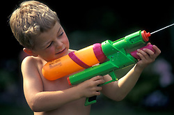Boy with supersoaker water gun UK